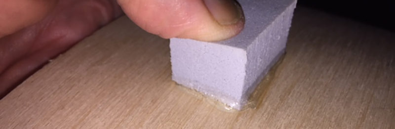 A piece of rubber glued to a rotary board with too much glue